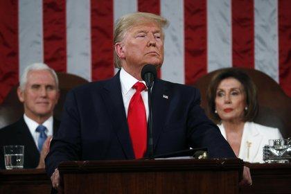 El presidente Donald Trump pronuncia su discurso del Estado de la Unión en una sesión conjunta del Congreso, en el Capitolio, Washington, el martes 4 de febrero de 2020. (Leah Millis/Pool via AP)