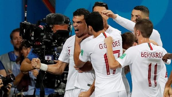 Soccer Football – World Cup – Round of 16 – Uruguay vs Portugal – Fisht Stadium, Sochi, Russia – June 30, 2018 Portugal's Pepe celebrates scoring their first goal with Cristiano Ronaldo and team mates REUTERS/Toru Hanai