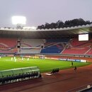 This handout photo taken on October 15, 2019 by the Korea Football Association (KFA) shows empty stands during the World Cup 2022 Qualifying Asian zone Group H football match between South Korea (in white) and North Korea at Kim Il Sung Stadium in Pyongyang. - A World Cup qualifier like no other kicked off in Pyongyang on October 15, with North and South Korea playing to an empty stadium in a match almost completely blocked off from the outside world. (Photo by handout / Korea Football Association / AFP) / - South Korea OUT / REPUBLIC OF KOREA OUT RESTRICTED TO EDITORIAL USE - MANDATORY CREDIT
