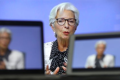 """Christine Lagarde, president of the European Central Bank (ECB), speaks during a live stream video of the central bank's virtual rate decision news conference in Frankfurt, Germany, on a television screen arranged in Danbury, U.K., on Thursday, Oct. 29, 2020. Lagarde said there is """"little doubt"""" that policy makers will agree on a new package of monetary stimulus in December as coronavirus infections and renewed lockdowns threaten a double-dip recession."""