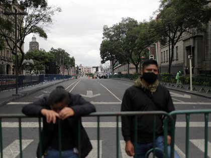 Presidential guards keep watch on closed up streets near Zocalo square, prior to Mexico marking the 210th anniversary of its independence from Spain at the National Palace in Mexico City, Mexico September 14, 2020. REUTERS/Henry Romero