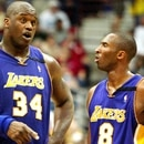 Los Angeles Lakers' guard Kobe Bryant (R) and teammate Shaquille O'Neal discuss the game during the third quarter against the Minnesota Timberwolves in NBA playoffs, April 20, 2003 at the Target center in Minneapolis. The Lakers won the game, 117-98. Pictures of the month April 2003 REUTERS/Jeff Christensen JC/HB