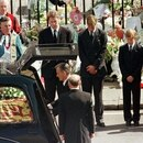FILE PHOTO: Earl Spencer, Prince William, Prince Harry and Prince Charles watch as the coffin of Diana, Princess of Wales is placed into a hearse at Westminster Abbey following her funeral service, London, Britain September 6, 1997. REUTERS/Kieran Doherty/File Photo