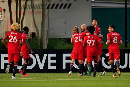 Apr 14, 2021; Kissimmee, Florida, USA; Toronto FC players celebrate the goal scored by forward Patrick Mullins (13) during the second half against Leon at ESPN Wide World of Sports Complex. Mandatory Credit: Jasen Vinlove-USA TODAY Sports