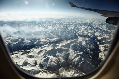 ZURICH, SWITZERLAND - FEBRUARY 21: Snow covered alpine mountains seen from a commercial flight from Athens International Airport to Heathrow Airport on February 21, 2012 in Zurich, Switzerland. (Photo by Oli Scarff/Getty Images)