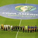 Soccer Football - Copa America Brazil 2019 - Group B - Argentina v Colombia - Arena Fonte Nova, Salvador, Brazil - June 15, 2019 Teams line up during the national anthems before the match REUTERS/Rodolfo Buhrer