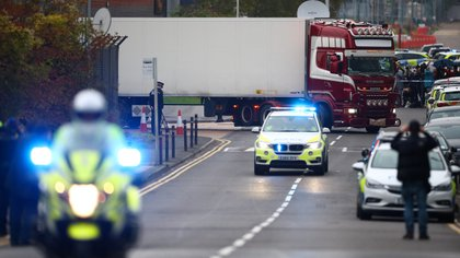 Police move the lorry container where bodies were discovered, in Grays, Essex, Britain October 23, 2019.  REUTERS/Hannah McKay