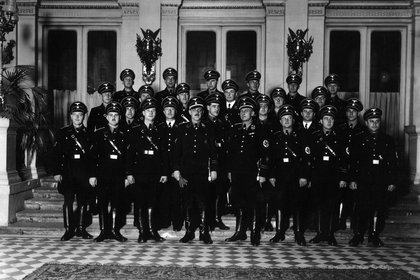 In an undated photo provided by the National Archives of Slovenia, Franz Josef Huber, front row center holding gloves, poses with his Vienna Gestapo team.  Huber, responsible for deporting tens of thousands of Jews, escaped punishment with U.S. backing and went on to work for West German intelligence, newly disclosed records reveal. (National Archives of Slovenia via The New York Times) -- NO SALES; FOR EDITORIAL USE ONLY WITH NYT STORY NAZI ROLE REVEALED BY RONEN BERGMAN FOR APRIL 6, 2021. ALL OTHER USE PROHIBITED. --