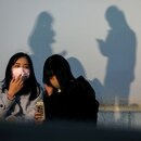 FILE PHOTO: FILE PICTURE: People wearing protective masks are pictured in the Shibuya district in Tokyo, Japan, February 24, 2020. REUTERS/Athit Perawongmetha/File Photo