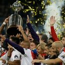 Argentina's River Plate players hold the trophy aloft as they celebrate their victory in the Copa Libertadores final soccer match at the Santiago Bernabeu stadium in Madrid, Spain, Monday, Dec. 10, 2018. (AP Photo/Thanassis Stavrakis)