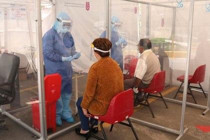 50,000 pruebas fueron parte de una donación de Alemania y las otras fueron conseguidas por convenios con instituciones sanitarias (Foto: REUTERS/Henry Romero)