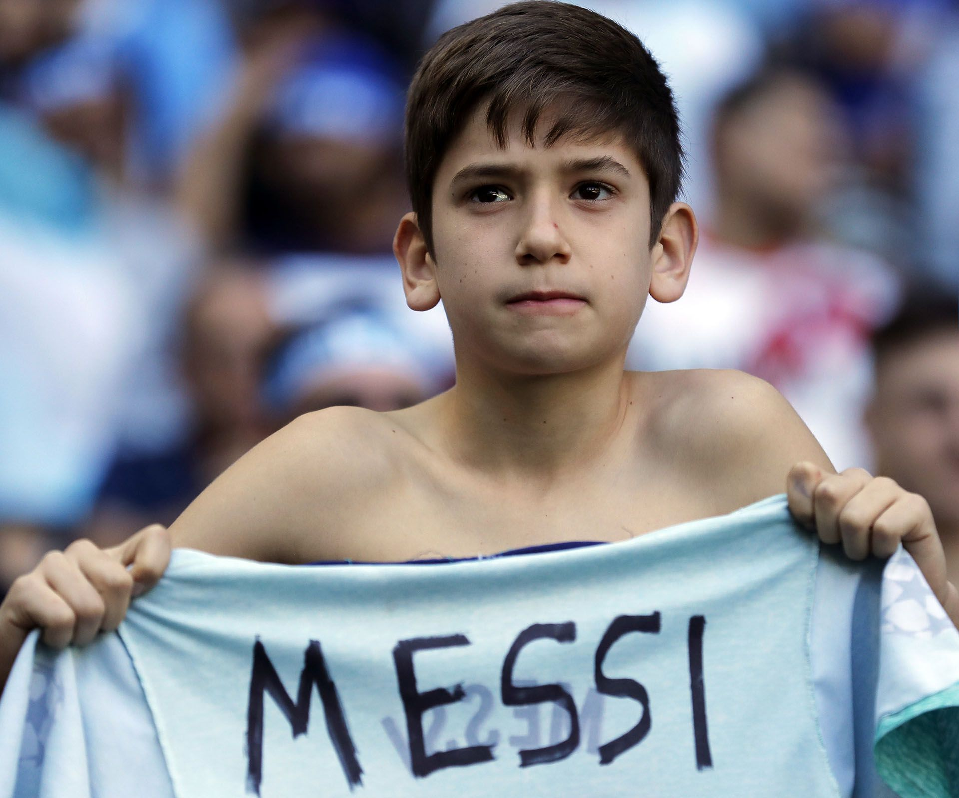 A young Argentina fan holds a T-shirt with the name of Lionel Messi prior to his team's Copa America Group B soccer match against Qatar at Arena do Gremio in Porto Alegre, Brazil, Sunday, June 23, 2019. (AP Photo/Victor R. Caivano)