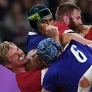 France's lock Sebastien Vahaamahina (black cap) elbows Wales' flanker Aaron Wainwright (L) during the Japan 2019 Rugby World Cup quarter-final match between Wales and France at the Oita Stadium in Oita on October 20, 2019. (Photo by CHARLY TRIBALLEAU / AFP)