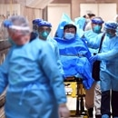Medical staff transfer a patient of a highly suspected case of a new coronavirus at the Queen Elizabeth Hospital in Hong Kong, China January 22, 2020. Picture taken January 22, 2020. cnsphoto via REUTERS. ATTENTION EDITORS - THIS IMAGE WAS PROVIDED BY A THIRD PARTY. CHINA OUT. TPX IMAGES OF THE DAY