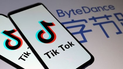 FILE PHOTO: Tik Tok logos are seen on smartphones in front of a displayed ByteDance logo in this illustration taken November 27, 2019. REUTERS/Dado Ruvic/Illustration