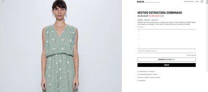 """Se trata de un vestido midi con escote pico y manga sisa amplia. Tal como se describe en la tienda online de Zara, la pieza posee """"cintura elástica y detalle tejido combinado a contraste. Forro interior y cierre frontal con botones forrados"""""""