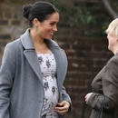 Meghan, the Duchess of Sussex, left, arrives for a visit to the Royal Variety Charity's residential nursing and care home, Brinsworth House, in Twickenham, west London, Tuesday Dec. 18, 2018. (Andrew Matthews/PA via AP)