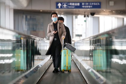 Pasajeros en el aeropuerto de Beijing (Reuters)