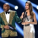 ATLANTA, GEORGIA - DECEMBER 08: (EDITORIAL USE ONLY) Steve Harvey interviews Miss Colombia Gabriela Tafur Nader onstage at the 2019 Miss Universe Pageant at Tyler Perry Studios on December 08, 2019 in Atlanta, Georgia. Paras Griffin/Getty Images/AFP