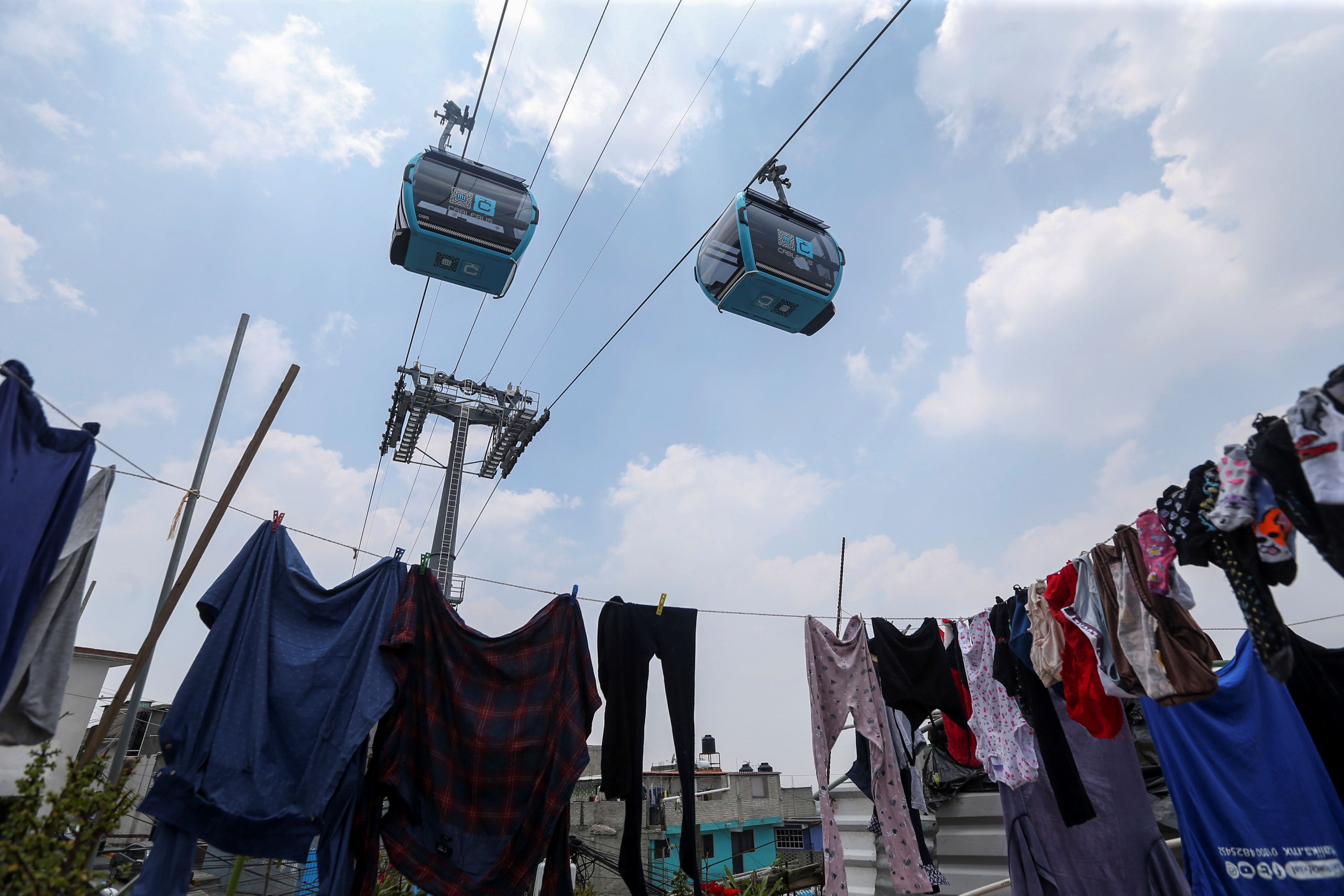 A general view shows the line of a cable car system dubbed the Cablebus during the inauguration of a section in Mexico City, Mexico, July 11, 2021. REUTERS/Edgard Garrido
