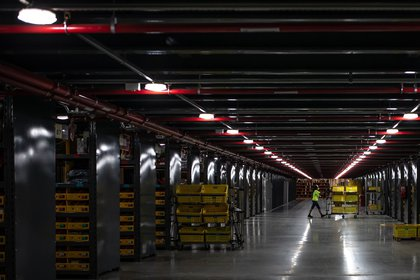 A worker pushes a cart at a MercadoLibre Inc. distribution and fulfillment center in Cajamar, Sao Paulo state, Brazil on Friday, Nov. 27, 2020. MercadoLibre is having another year of strong top-line growth, likely reaching 65% in 2020, after a slow start when the Covid-19 pandemic led to government lockdowns.
