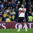 Lucas Pratto of Argentina's River Plate crosses his arms to celebrate scoring his side's opening goal against Argentina's Boca Juniors during the Copa Libertadores final soccer match at the Santiago Bernabeu stadium in Madrid, Spain, Sunday, Dec. 9, 2018. (AP Photo/Manu Fernandez)