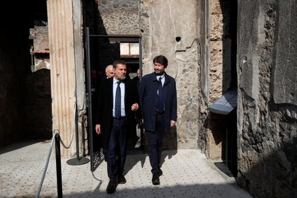 File photo: Massimo Osanna and Italian Culture Minister Dario Franceschini walking in one of the three restored domus (old houses) at the archaeological site of Pompeii, Italy, on February 18, 2020. REUTERS / Ciro De Luca