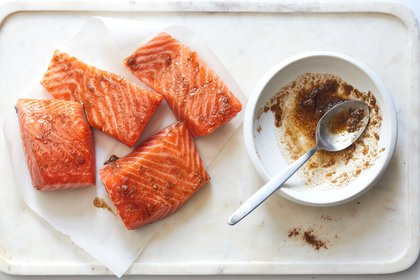 The salmon fillets are coated in a garlicky spice blend before being browned. Food Stylist: Rebecca Jurkevich. (Beatriz Da Costa/The New York Times)
