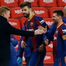 Barcelona's Lionel Messi shakes hands with Barcelona's head coach Ronald Koeman at the end of the the Copa del Rey semifinal, second leg, soccer match between FC Barcelona and Sevilla FC at the Camp Nou stadium in Barcelona, Spain, Wednesday March 3, 2021. Barcelona won 3-0. (AP Photo/Joan Monfort)