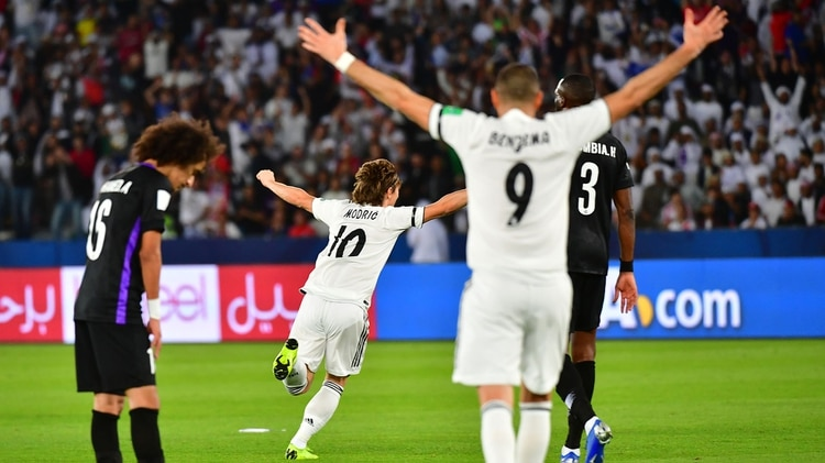 Real Madridâ??s Croatian midfielder Luka Modric (C, #10) celebrates his goal during the Final match in the FIFA Club World Cup football competition between Real Madrid and Al-Ain at the Zayed Sports City Stadium in Abu Dhabi, the capital of the United Arab Emirates, on December 22, 2018. (Photo by Giuseppe CACACE / AFP)