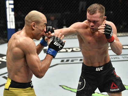 July 12, 2020; Abu Dhabi, UAE; Petr Yan of Russia punches Jose Aldo of Brazil in their UFC bantamweight championship fight during the UFC 251 event at Flash Forum on UFC Fight Island on July 12, 2020 on Yas Island, Abu Dhabi, United Arab Emirates.  Mandatory Credit: Jeff Bottari/Zuffa LLC via USA TODAY Sports