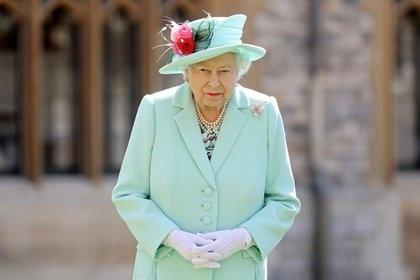 FOTO DE ARCHIVO: El veterano capitán Tom recibe distinción de caballero de la reina británica Isabel en el Castillo de Windsor, Gran Bretaña, el 17 de julio de 2020. Chris Jackson/Pool via REUTERS/