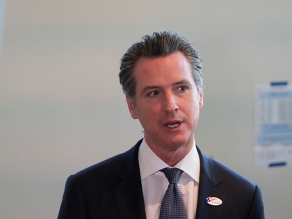 FILE PHOTO: California Governor Gavin Newsom speaks to the media after at a voting center for the presidential primaries on Super Tuesday in Sacramento, CA, U.S., March 3, 2020. REUTERS/Gabriela Bhaskar/File Photo