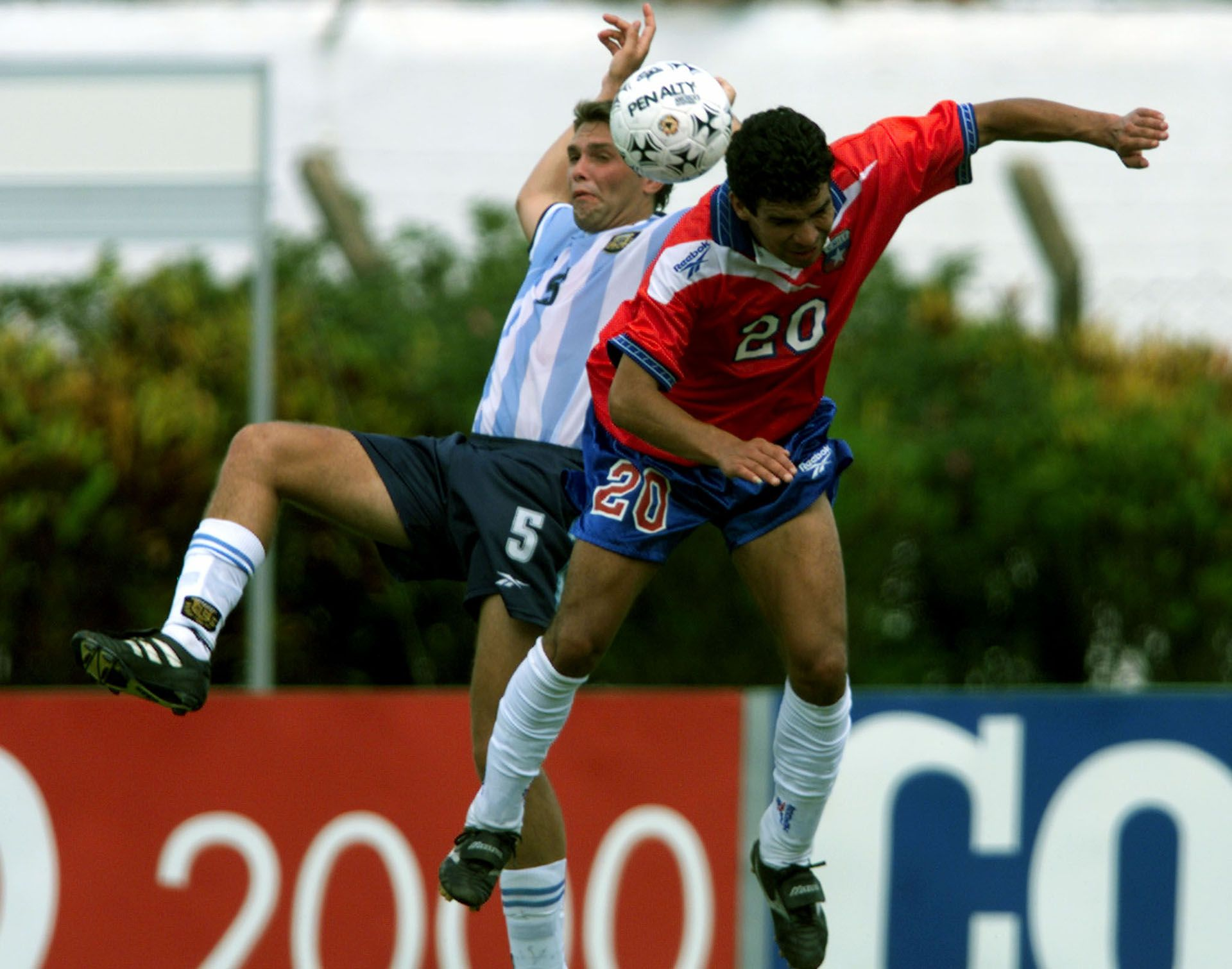 NUNEZ FROM CHILE IN ACTION WITH MARKIC FROM ARGENTINA AT PRE OLYMPIC MATCH IN LONDRINA.