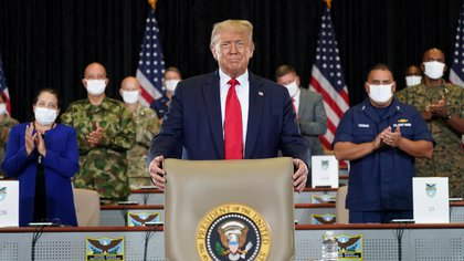 U.S. President Donald Trump arrives at his seat to attend a briefing on SOUTHCOM Enhanced Counternarcotics Operations while visiting the U.S. Southern Command (SOUTHCOM) in Doral, Florida, U.S., July 10, 2020. REUTERS/Kevin Lamarque