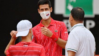 Tennis - ATP Masters 1000 - Italian Open - Foro Italico, Rome, Italy - September 21, 2020  Serbia's Novak Djokovic and Argentina's Diego Schwartzman wear protective face masks before the final  Riccardo Antimiani/Pool via REUTERS