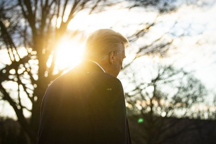 U.S. President Donald Trump walks on the South Lawn of the White House before boarding Marine One in Washington, D.C., U.S., on Wednesday, Jan. 20, 2021. Trump departs Washington with Americans more politically divided and more likely to be out of work than when he arrived, while awaiting trial for his second impeachment - an ignominious end to one of the most turbulent presidencies in American history. Photographer: Al Drago/Bloomberg