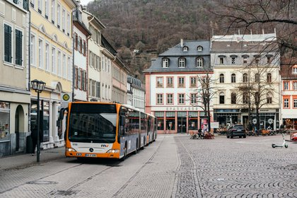 Public electric buses in a historic area of Heidelberg, Germany, Feb. 4, 2021. The city, at the forefront of a movement to get rid of internal combustion engines, offers free public transportation for a year to residents who give up their cars. (Felix Schmitt/The New York Times)