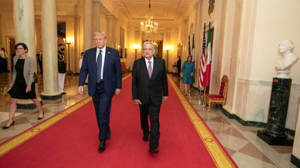 U.S. President Donald Trump and Mexico's President Andres Manuel Lopez Obrador arrive for a dinner at the White House, in Washington, U.S. July 8, 2020. Mexico's Presidency/Handout via REUTERS ATTENTION EDITORS - THIS IMAGE HAS BEEN SUPPLIED BY A THIRD PARTY. NO RESALES. NO ARCHIVES