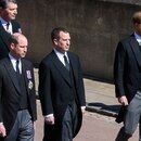 Britain's Prince William, Duke of Cambridge, Britain's Prince Harry, Duke of Sussex and Peter Phillips follow the hearse, a specially modified Land Rover, during the funeral of Britain's Prince Philip, husband of Queen Elizabeth, who died at the age of 99, on the grounds of Windsor Castle in Windsor, Britain, April 17, 2021. Leon Neal/Pool via REUTERS