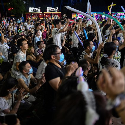 This photo taken on August 4, 2020 shows people participating in a music festival in Wuhan in China's central Hubei province. - The city's convalescence since a 76-day quarantine was lifted in April has brought life and gridlocked traffic back onto its streets, even as residents struggle to find their feet again. Long lines of customers now stretch outside breakfast stands, a far cry from the terrified crowds who queued at city hospitals in the first weeks after a city-wide lockdown was imposed in late January to curb the spread of the COVID-19 coronavirus. (Photo by Hector RETAMAL / AFP)