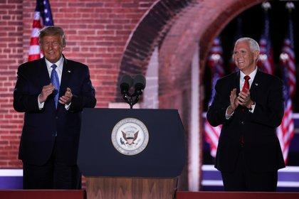Pence junto a Donald Trump.  REUTERS / Jonathan Ernst