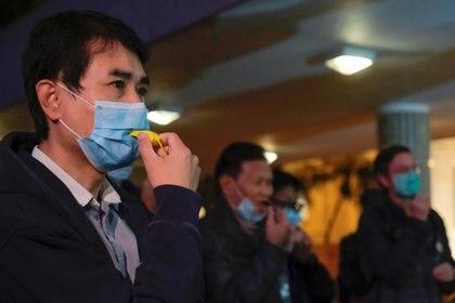 Los especialistas también pidieron que no se aliente el temor ni la xenofobia. (Foto: Tyrone Siu/Reuters)