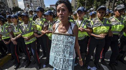 La miseria ha ganado las calles en Venezuela. / AFP PHOTO / JUAN BARRETO