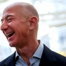 FILE PHOTO: FILE PHOTO: Amazon founder and CEO Jeff Bezos laughs as he talks to the media while touring the new Amazon Spheres during the grand opening at Amazon's Seattle headquarters in Seattle, Washington, U.S., January 29, 2018. REUTERS/Lindsey Wasson/File Photo/File Photo