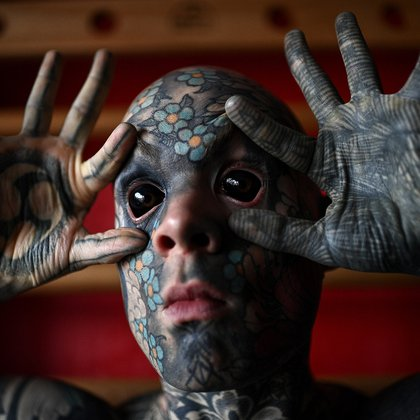 French primary school teacher and tattoo enthusiast Sylvain Helaine, known as Freaky Hoody, poses during a photo session in Palaiseau, a south of Paris suburb, on September 22, 2020. (Photo by Christophe ARCHAMBAULT / AFP)