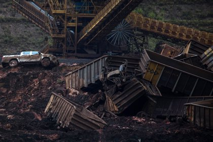 Bloomberg Best of the Year 2019: A pick up truck sits among shattered debris after a dam breach at the Vale SA iron ore mine in Brumadinho, Minas Gerais state, Brazil, on Saturday, Jan. 26, 2019.