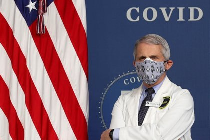 National Institute of Allergy and Infectious Diseases Director Dr. Anthony Fauci  stands by during an event to commemorate the 50 millionth coronavirus disease (COVID-19) vaccination in the South Court Auditorium at the White House in Washington, U.S., February 25, 2021. REUTERS/Jonathan Ernst