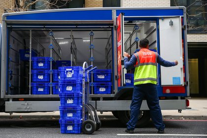 An employee of Tesco Plc unloads groceries from a truck as he prepares a delivery in London, U.K., on Wednesday, Sept. 30, 2020. Covid-19 lockdown enabled online and app-based grocery delivery service providers to make inroads with customers they had previously struggled to recruit, according the Consumer Radar report by BloombergNEF. Photographer: Hollie Adams/Bloomberg