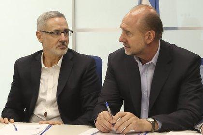 El gobernador de Santa Fe, Omar Perotti y el ministro de Seguridad de la provincia, Marcelo Sain